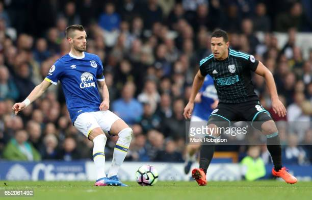 Morgan Schneiderlin of Everton passes the ball while under pressure from Jake Livermore of West Bromwich Albion during the Premier League match...