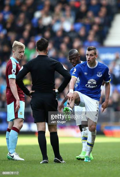 Morgan Schneiderlin of Everton points to his shin after a challenge from Joey Barton of Burnley during the Premier League match between Everton and...