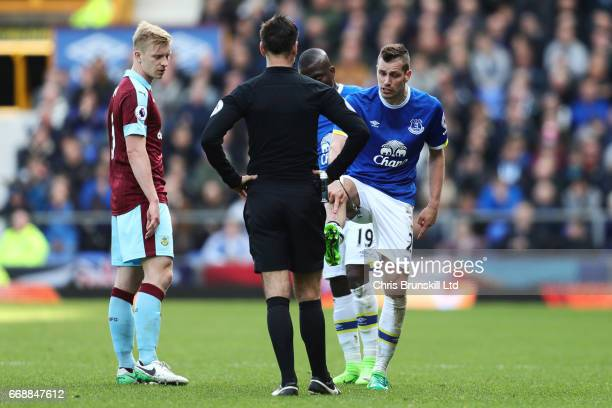 Morgan Schneiderlin of Everton protests to Referee Mark Clattenburg during the Premier League match between Everton and Burnley at Goodison Park on...