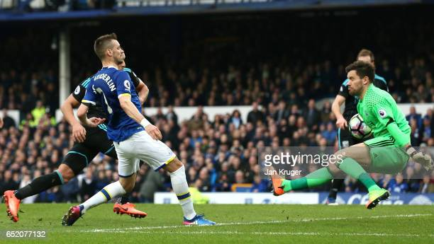 Morgan Schneiderlin of Everton scores his sides second goal past Ben Foster of West Bromwich Albion during the Premier League match between Everton...