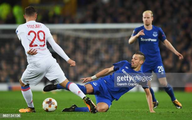 Morgan Schneiderlin of Everton stretches to tackle Lucas Tousart of Lyon during the UEFA Europa League Group E match between Everton FC and Olympique...