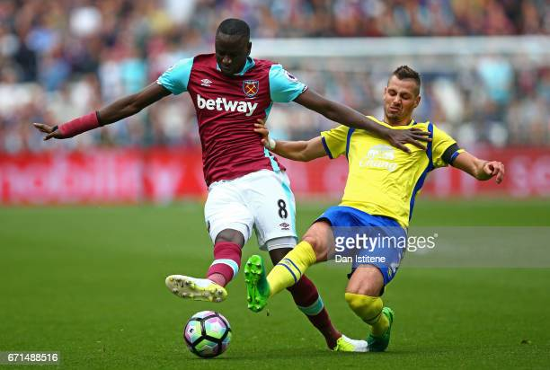 Morgan Schneiderlin of Everton tackles Cheikhou Kouyate of West Ham United during the Premier League match between West Ham United and Everton at the...