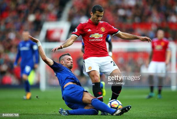 Morgan Schneiderlin of Everton tackles Henrikh Mkhitaryan of Manchester United during the Premier League match between Manchester United and Everton...