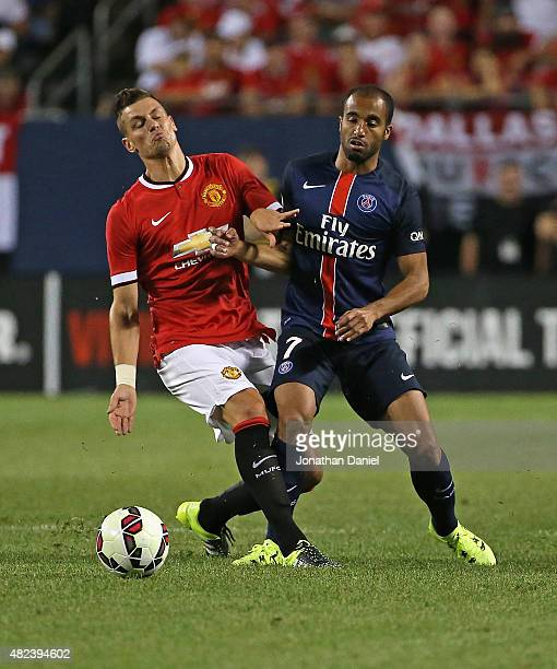 Morgan Schneiderlin of Manchester United and Lucas Moura of Paris SaintGermain battle for the ball during a match in the 2015 International Champions...