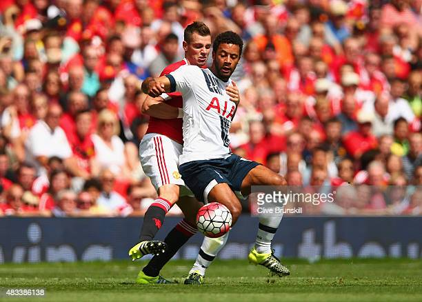 Morgan Schneiderlin of Manchester United and Mousa Dembele of Tottenham Hotspur compete for the ball during the Barclays Premier League match between...