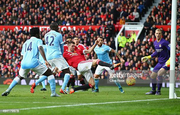 Morgan Schneiderlin of Manchester United dives for the ball during the Barclays Premier League match between Manchester United and Manchester City at...