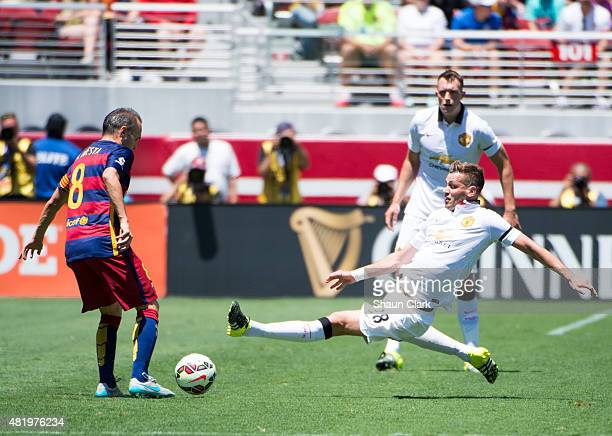 Morgan Schneiderlin of Manchester United lunges for a ball controlled by Andres Iniesta of Barcelona during the International Champions Cup 2015...