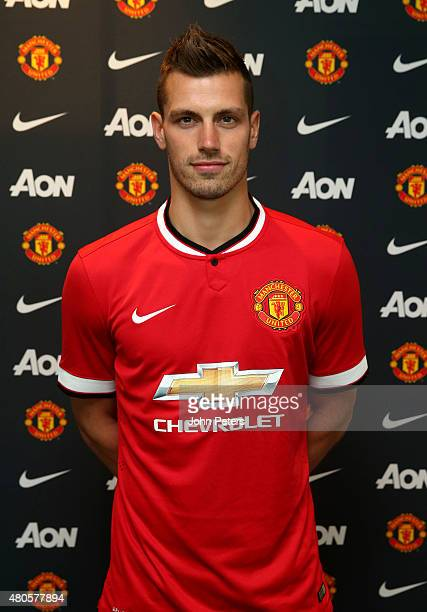 Morgan Schneiderlin of Manchester United poses after signing for the club at Aon Training Complex on July 13 2015 in Manchester England