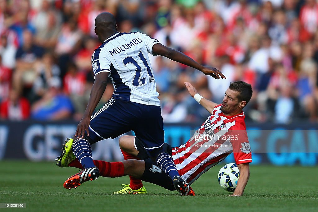 Morgan Schneiderlin of Southampton and Youssuf Mulumbu of West Brom battle for the ball during the Barclays Premier League match between Southampton and West Bromwich Albion at St Mary's Stadium on August 23, 2014 in Southampton, England.