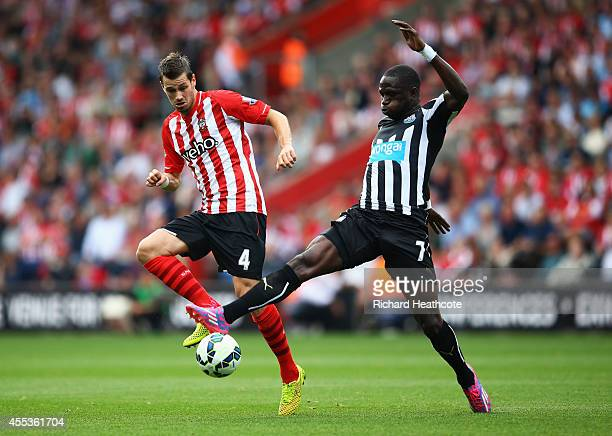 Morgan Schneiderlin of Southampton battles with Moussa Sissoko of Newcastle United during the Barclays Premier League match between Southampton and...
