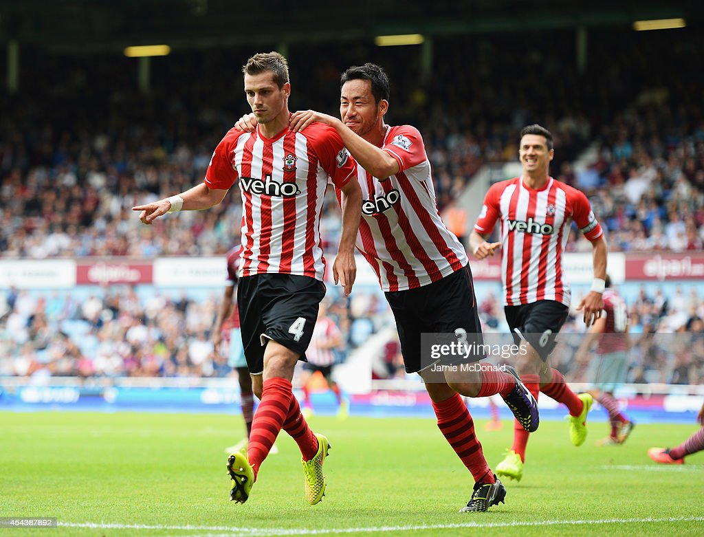 Morgan Schneiderlin of Southampton celebrates scoring his opening goal with Maya Yoshida of Southampton during the Barclays Premier League match between West Ham United and Southampton at Boleyn Ground on August 30, 2014 in London, England.