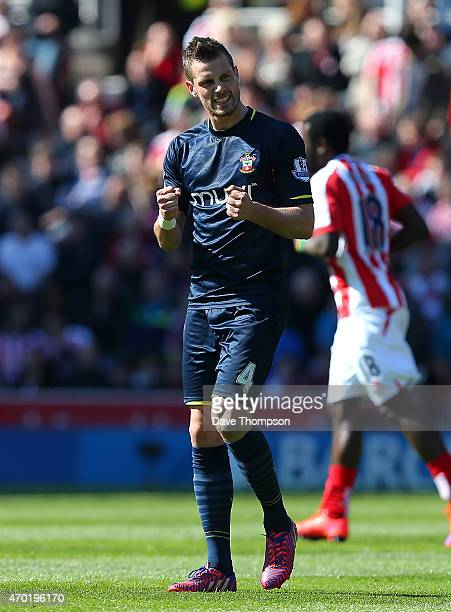 Morgan Schneiderlin of Southampton celebrates scoring the first goal during the Barclays Premier League match between Stoke City and Southampton at...