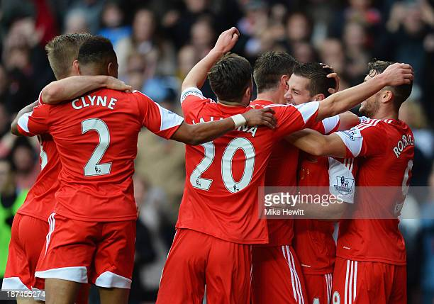 Morgan Schneiderlin of Southampton is congratulated by team mates as he scores their first goal during the Barclays Premier League match between...