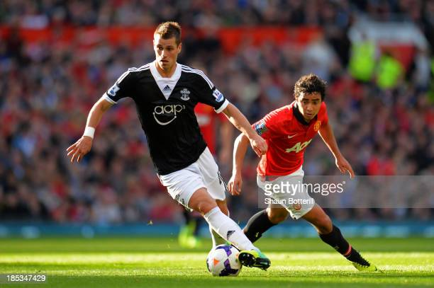 Morgan Schneiderlin of Southampton is pursed by Rafael of Manchester United during the Barclays Premier League match between Manchester United and...