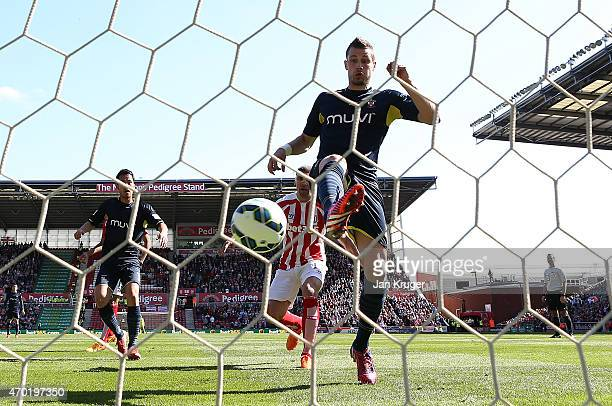 Morgan Schneiderlin of Southampton scores the first goal during the Barclays Premier League match between Stoke City and Southampton at the Britannia...