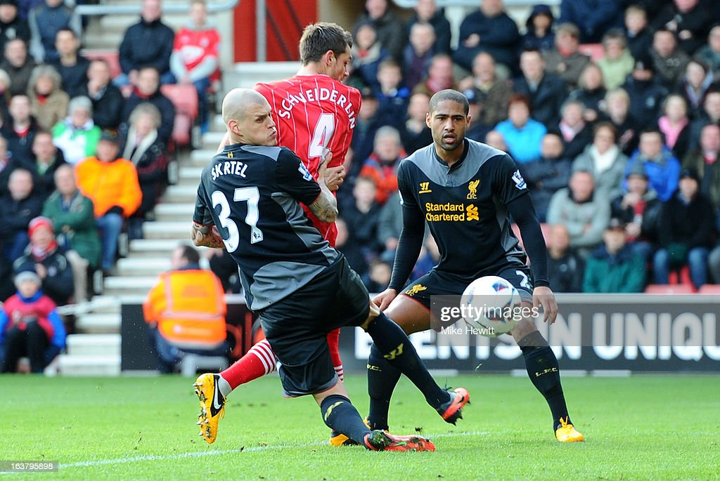 <a gi-track='captionPersonalityLinkClicked' href=/galleries/search?phrase=Morgan+Schneiderlin&family=editorial&specificpeople=4191360 ng-click='$event.stopPropagation()'>Morgan Schneiderlin</a> of Southampton scores the opening goal during the Barclays Premier League match between Southampton and Liverpool at St Mary's Stadium on March 16, 2013 in Southampton, England.
