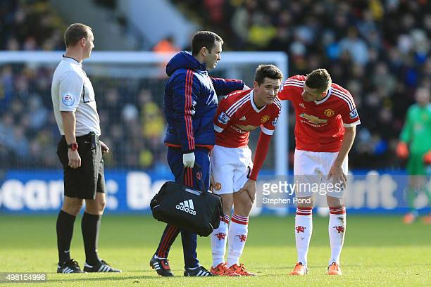 Morgan Schneiderlin talks to Ander Herrera while Herrera receiving a medical treatment during the Barclays Premier League match between Watford and...