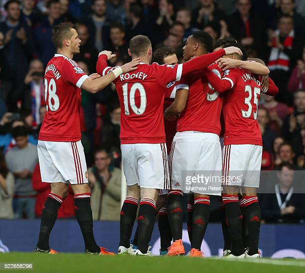 Morgan Schneiderlin Wayne Rooney and Anthony Martial of Manchester United celebrate Damien Delaney of Crystal Palace scoring an owngoal during the...