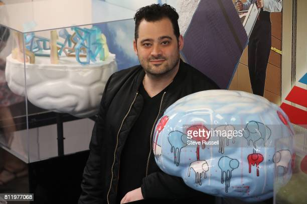 TORONTO ON JUNE 27 Morgan Sheardown with 'Raining Cows Blue Sun' On July 11 more than 100 vibrantly coloured sculptures of human brains will be...