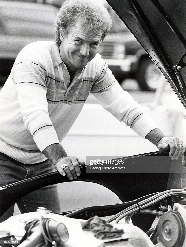Morgan Shepherd checks out his engine before the Nationwise 500. Shepherd would finish 24th and take home $6,625 for the race.