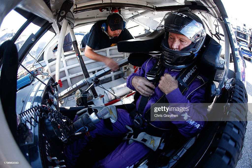 Morgan Shepherd, driver of the #89 King's Tire Chevrolet, pulls on his seat belts inside his car during practice for the NASCAR Nationwide Series Virginia 529 College Savings 250 at Richmond International Raceway on September 6, 2013 in Richmond, Virginia.