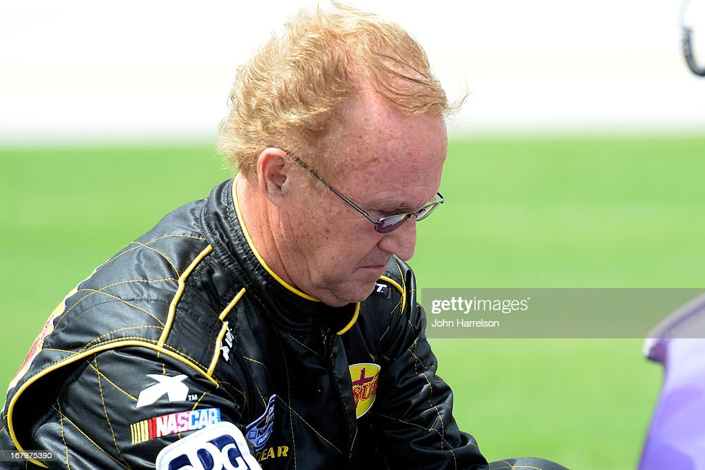 Morgan Shepherd driver of the Victory in Jesus Dodge walks on the grid during qualifying for the NASCAR Nationwide Series Aaron's 312 at Talladega...