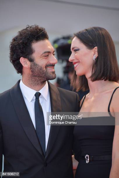Morgan Spector and Rebecca Hall walk the red carpet ahead of the 'Suburbicon' screening during the 74th Venice Film Festival at Sala Grande on...