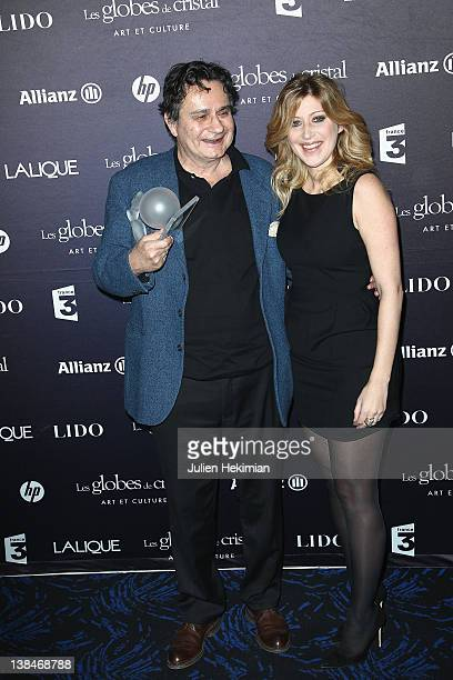 Morgan Sportes poses with Amanda Sthers after being awarded at the Globes de Cristal ceremony at Le Lido on February 6 2012 in Paris France