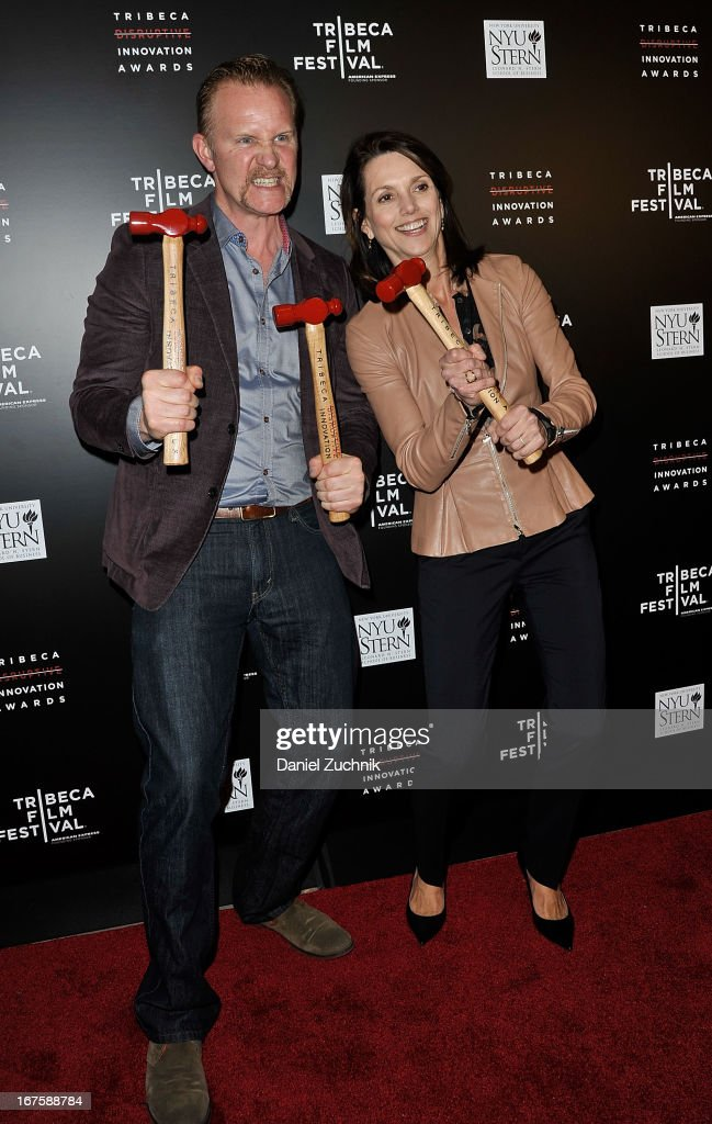 Morgan Spurlock and Beth Comstock (R) attend the 4th annual Tribeca Disruptive Innovation Awards during the 2013 Tribeca Film Festival at NYU Paulson Auditorium on April 26, 2013 in New York City.