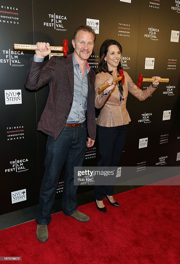 <a gi-track='captionPersonalityLinkClicked' href=/galleries/search?phrase=Morgan+Spurlock&family=editorial&specificpeople=212719 ng-click='$event.stopPropagation()'>Morgan Spurlock</a> and Beth Comstock attend Tribeca Disruptive Innovation Awards on April 26, 2013 in New York City.