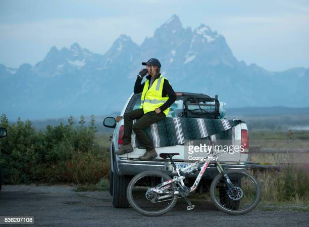 Morgan Squires a park employee waits to help park and manage cars as they arrive to view the solar eclipse in Grand Teton National Park on August 21...