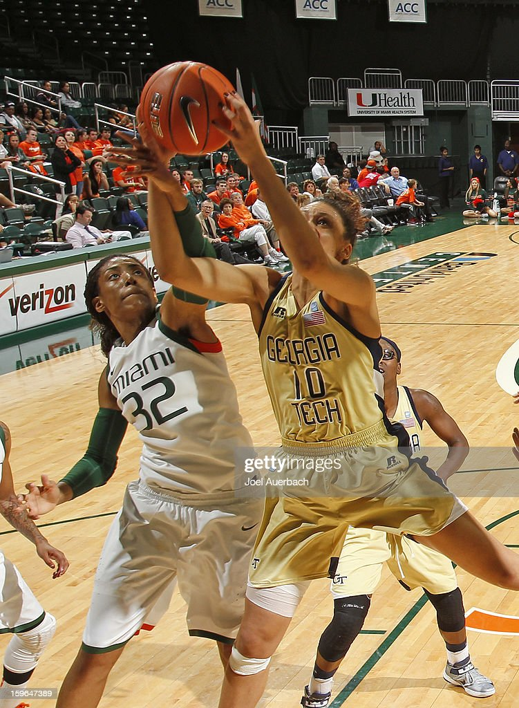 Morgan Stroman #32 of the Miami Hurricanes and Danielle Hamilton-Carter #10 of the Georgia Tech Yellow Jackets battle for control of the rebound on January 17, 2013 at the BankUnited Center in Coral Gables, Florida. Miami defeated Georgia Tech 71-65.