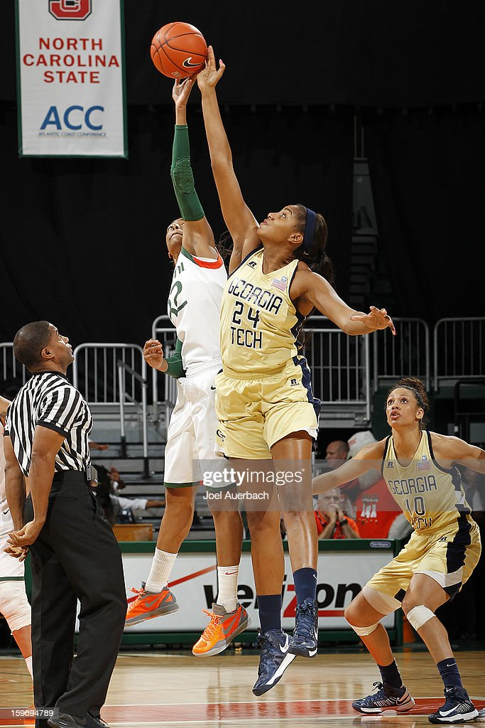 Morgan Stroman #32 of the Miami Hurricanes and Shayla Bivins #24 of the Georgia Tech Yellow Jackets jump during th opening tip off on January 17, 2013 at the BankUnited Center in Coral Gables, Florida. Miami defeated Georgia Tech 71-65.