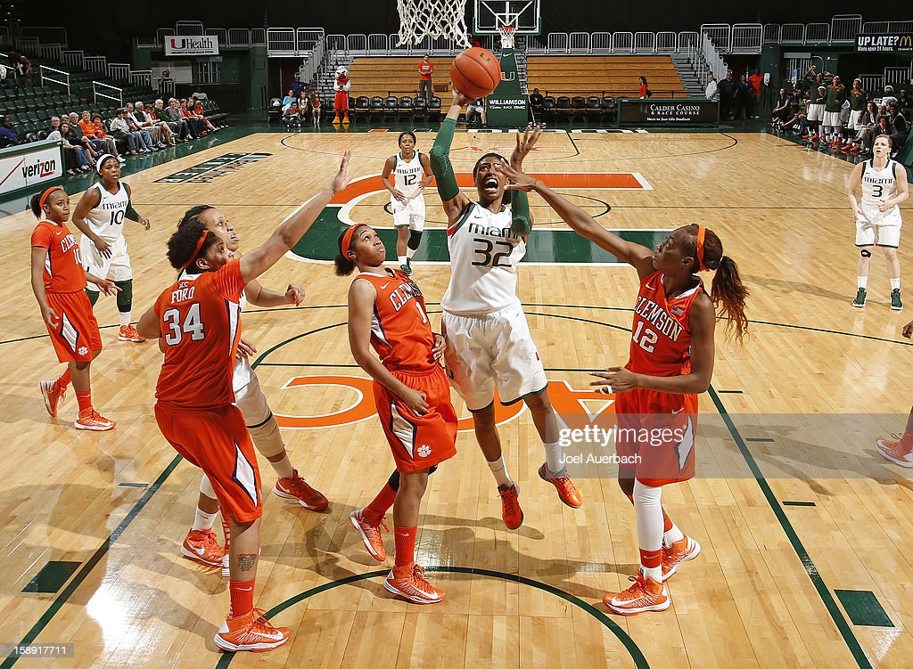 Morgan Stroman #32 of the Miami Hurricanes goes to the basket between Charmaine Tay #1 and Quinyotta Pettaway #12 of the Clemson Lady Tigers on January 3, 2013 at the BankUnited Center in Coral Gables, Florida. miami defeated Clemson 78-56.