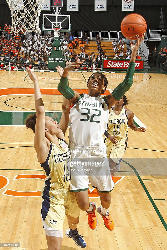 Morgan Stroman #32 of the Miami Hurricanes goes to the basket pst Danielle Hamilton-Carter #10 of the Georgia Tech Yellow Jackets on January 17, 2013 at the BankUnited Center in Coral Gables, Florida. Miami defeated Georgia Tech 71-65.