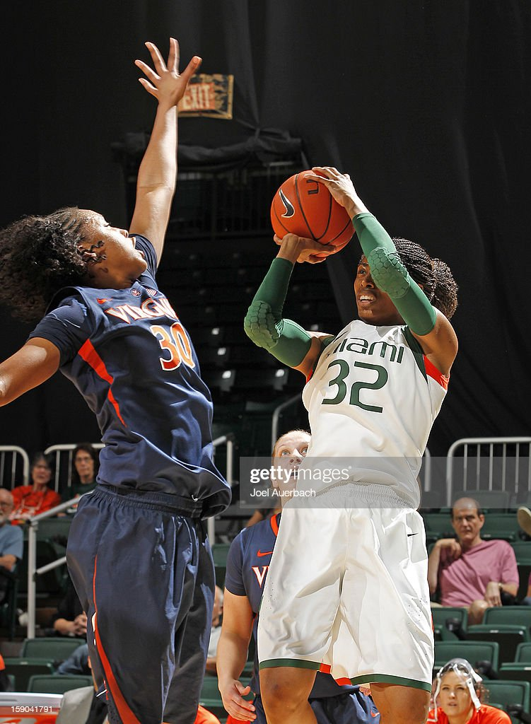 Morgan Stroman #32 of the Miami Hurricanes goes up against Telia McCall #30 of the Virginia Cavaliers on January 6, 2013 at the BankUnited Center in Coral Gables, Florida. The Hurricanes defeated the Cavaliers 58-52.