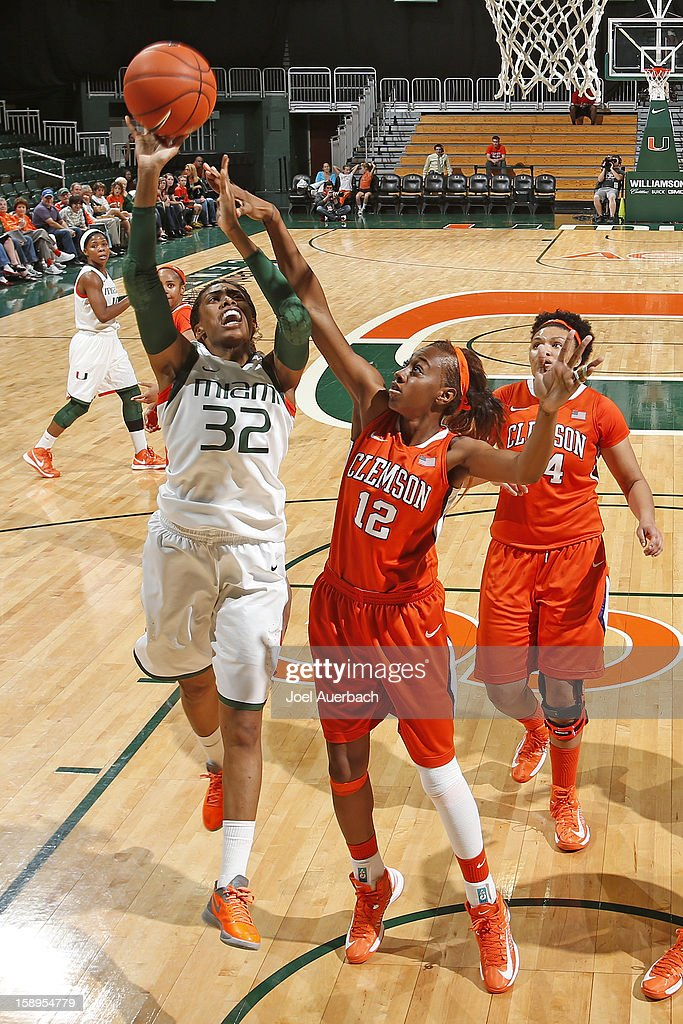 Morgan Stroman #32 of the Miami Hurricanes takes the shot past Quinyotta Pettaway #12 of the Clemson Lady Tigers on January 3, 2013 at the BankUnited Center in Coral Gables, Florida. miami defeated Clemson 78-56.