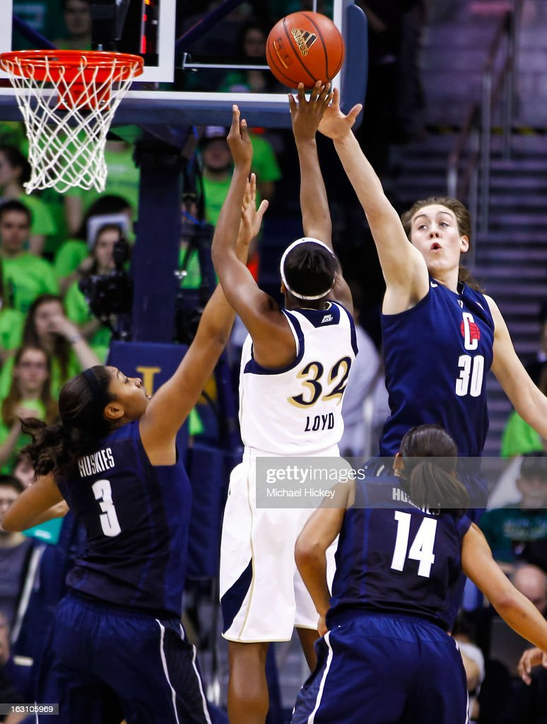 Morgan Tuck #3 of the Connecticut Huskies and Breanna Stewart #30 of the Connecticut Huskies defend as Jewell Loyd #32 of the Notre Dame Fighting Irish shoots a jumper at Purcel Pavilion on March 4, 2013 in South Bend, Indiana.