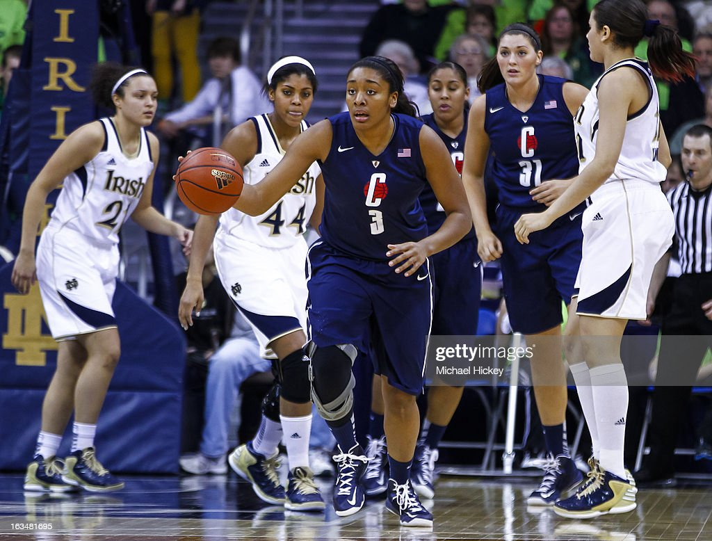 Morgan Tuck #3 of the Connecticut Huskies dribbles the ball up court against the Notre Dame Fighting Irish at Purcel Pavilion on March 4, 2013 in South Bend, Indiana. Notre Dame defeated Connecticut 96-87 in triple overtime to win the Big East regular season title.
