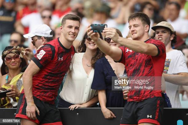 Morgan Williams and Owen Lane of Wales pose for selfies with the crowd after their final match in the 2017 HSBC Sydney Sevens at Allianz Stadium on...