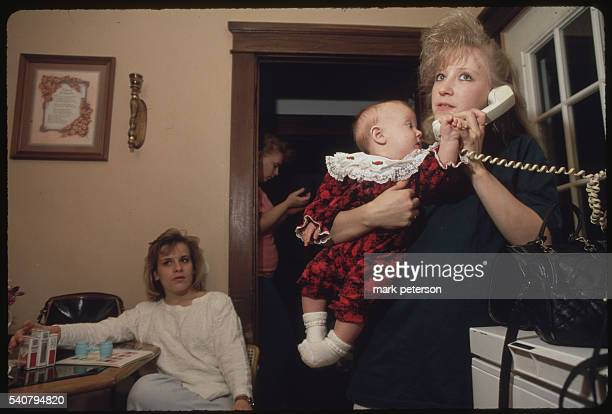 Morgantown West Virginia Deana Thomas with 6 month old Danielle at her mothers home with friend