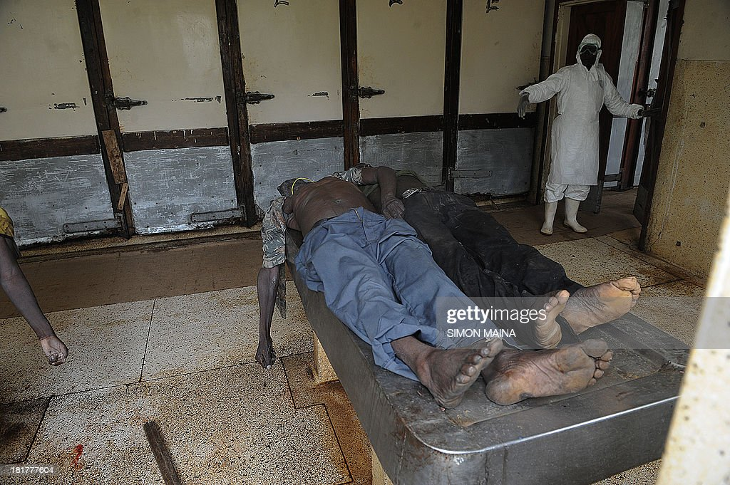 A morgue worker attends to bodies of the Westgate Mall attack at September 25, 2013 at Nairobi's mortuary. Kenyan troops and rescue workers scoured the wreckage of a Nairobi shopping mall on September 25, 2013 for bodies and booby-trapped explosives after a four-day siege by Islamist gunmen left 67 dead and dozens more missing.