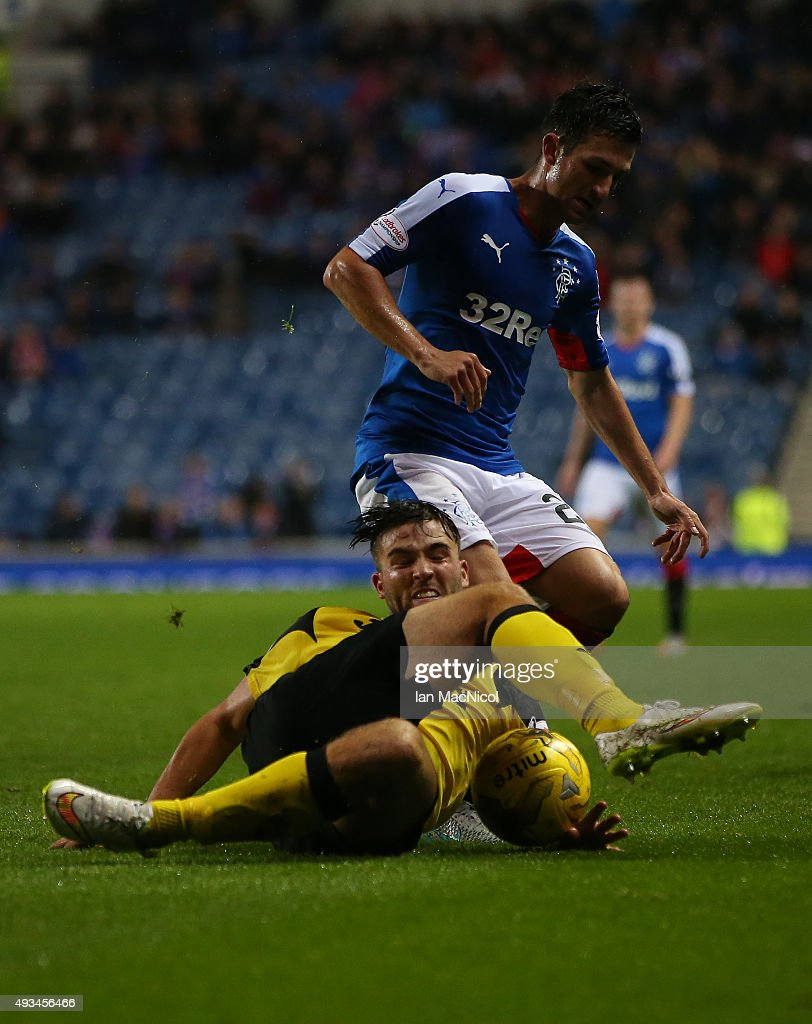 Morgyn Neill of Livingston vies with Jason Holt of Rangers during the Petrofac Training Cup Quarter-Final match between Rangers and Livingston at Ibrox Stadium on October 20, 2015 in Glasgow, Scotland.