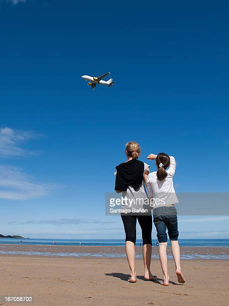 Morher and daughter looking at plane
