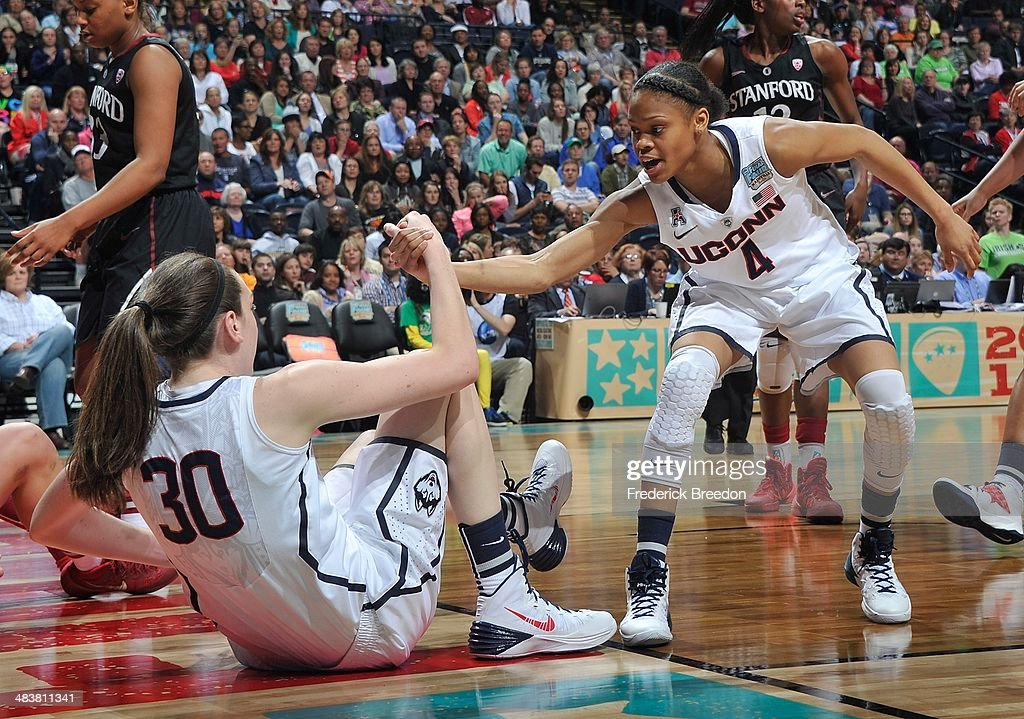 <a gi-track='captionPersonalityLinkClicked' href=/galleries/search?phrase=Moriah+Jefferson&family=editorial&specificpeople=9082577 ng-click='$event.stopPropagation()'>Moriah Jefferson</a> #4 of the Connecticut Huskies helps up teammate <a gi-track='captionPersonalityLinkClicked' href=/galleries/search?phrase=Breanna+Stewart&family=editorial&specificpeople=8564806 ng-click='$event.stopPropagation()'>Breanna Stewart</a> #30 during a game against the Stanford Cardinal at Bridgestone Arena on April 6, 2014 in Nashville, Tennessee.
