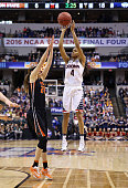 Moriah Jefferson of the Connecticut Huskies shoots against Sydney Wiese of the Oregon State Beavers in the first quarter during the semifinals of the...