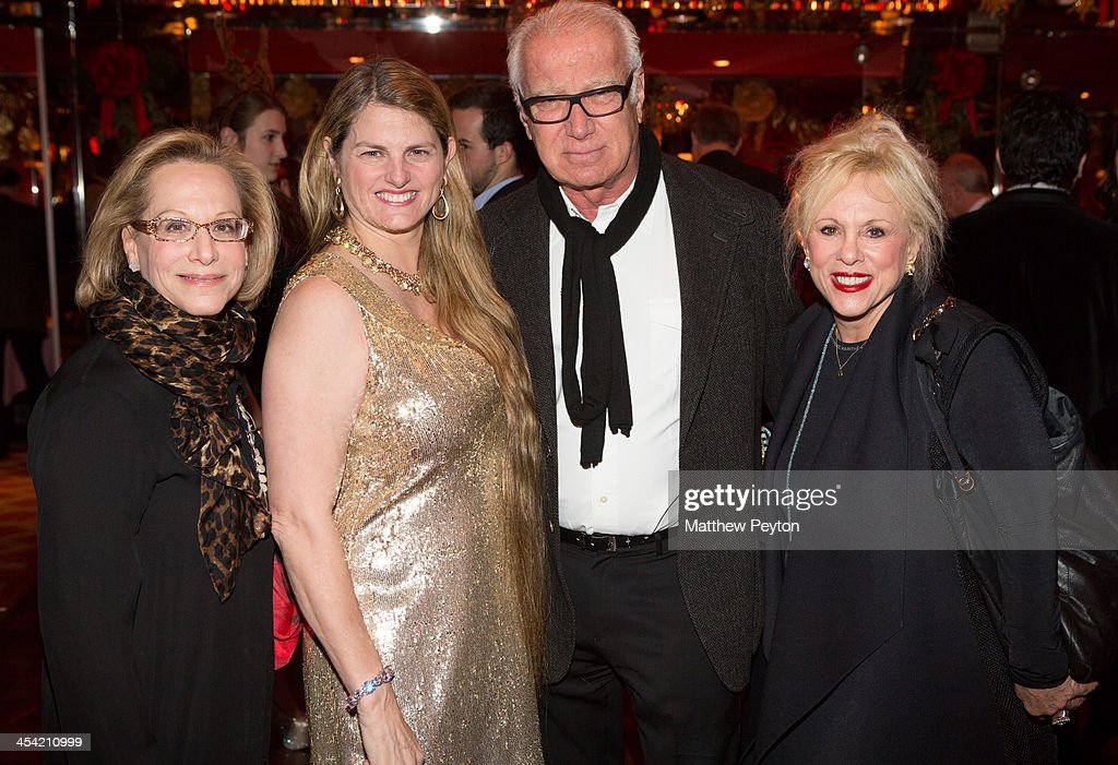 Morie Pearl, Bonnie Comley, Tom Dokton and Anita Waxman pose together at Stewart F. Lane - aka 'Mr. Broadway' & Bonnie Comley's Holiday Party at The Doubles Club on December 6, 2013 in New York City.