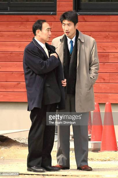 Moritomo Gakuen head director Yasunori Kagoike talks with his son Yoshishige at the school operator bought from government on March 16 2017 in...