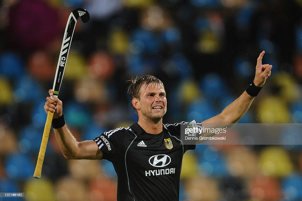 <a gi-track='captionPersonalityLinkClicked' href=/galleries/search?phrase=Moritz+Fuerste&family=editorial&specificpeople=657212 ng-click='$event.stopPropagation()'>Moritz Fuerste</a> of Germany celebrates after winning the Men's Eurohockey 2011 semi final match between Germany and England at Warsteiner HockeyPark on August 26, 2011 in Moenchengladbach, Germany.