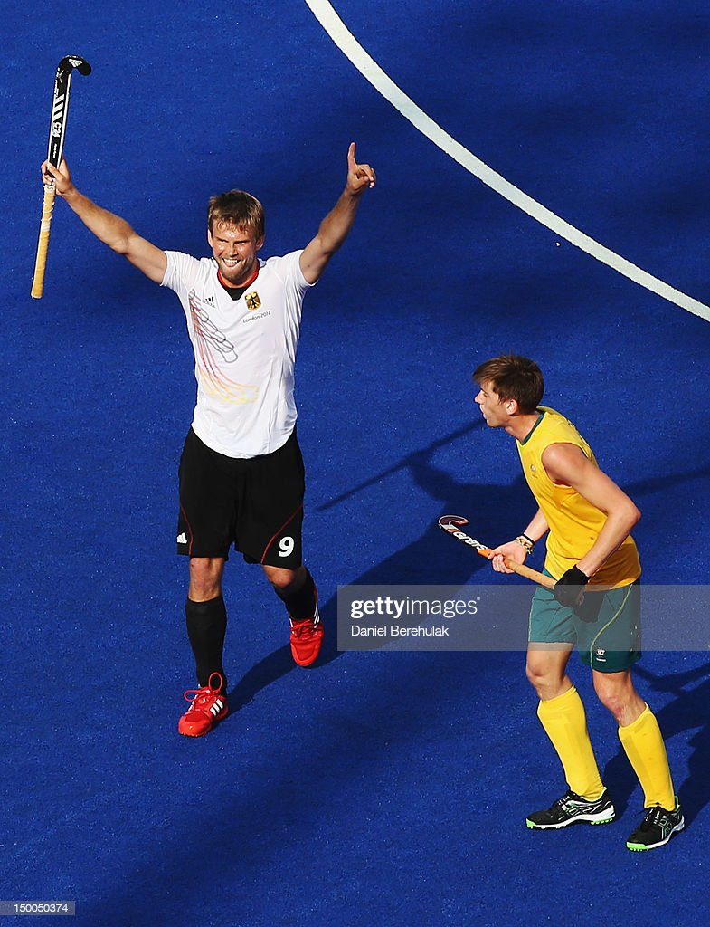 <a gi-track='captionPersonalityLinkClicked' href=/galleries/search?phrase=Moritz+Fuerste&family=editorial&specificpeople=657212 ng-click='$event.stopPropagation()'>Moritz Fuerste</a> of Germany celebrates moments before the end buzzerl during the Men's Hockey semi-final match between Australia and Germany on Day 13 of the London 2012 Olympic Games at Riverbank Arena Hockey Centre on August 9, 2012 in London, England.